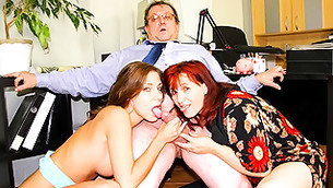 Two salacious women giving double blowjob to a middle-aged man