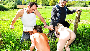 Two libertine chicks decided to give the blowjob to both guys in the field