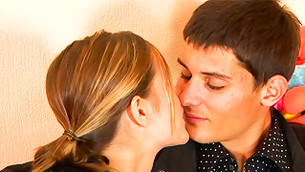 Perfect adorable young boy and girl are gently kissing each other