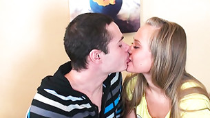 Beautiful young boy and girl are kissing so softly and gently