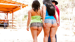 Two full-figured babes are busted walking outside in very sexy shorts