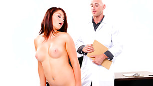 Unrestrained blonde is seductively striping in front of her doctor