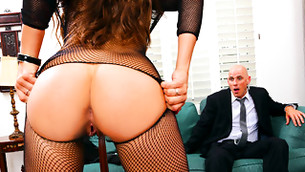 Carring wife is surprising her busy husband with alluring fishnet outfit