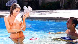 perplexed girl is staring at her boobs while her bikini drifting away