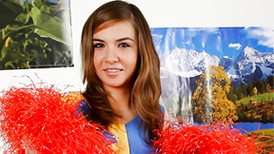 Slutty teenaged cheer leader is wearing her hottest and sexiest outfit