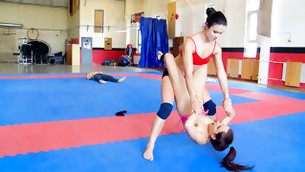 Sweet aroused whores in the gym are having fun with their beautiful bodies