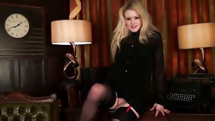Good looking blonde lass wearing tights is rubbing her sweet vagina