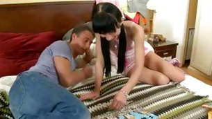 An smutty young sexy chick is smiling while dude is touching her prolonged legs