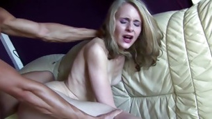 This blonde delicate whore is groaning while poured hard from behind
