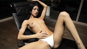 Black haired slut is demonstrating off her slim body in and clam in pants