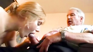 Golden haired honey is sucking on this huge pecker seductively and noxious