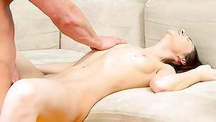 Angelic tanned miss is lying on her bed getting drilled deep and rough