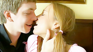 Beautiful blonde girl is making out seductively with this aroused stud