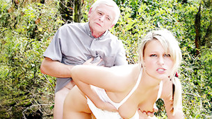 Libertine blonde gets prodded from behind by an ancient mister outdoors